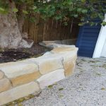 img-Curved Sandstone Ballast Wall