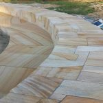 img-Sandstone Firepit And Curved Seat