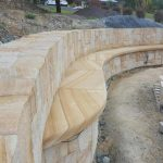 img-Split Sandstone Wall And Curved Seat
